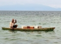 An elderly Tidung from a nearby floating...