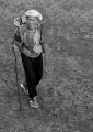 An elderly Kayan woman leaves her longho...
