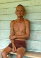 Jabu Anak Udin, an elderly Iban sits out...