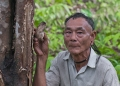 Olui Akem, a Penan from Long Belok holds...