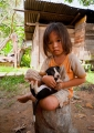 This little Penan girl and her puppy wer...