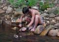A young Penan hunter sharpens his 'nahat...