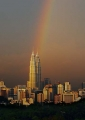 A rainbow illuminates the Petronas Twin ...
